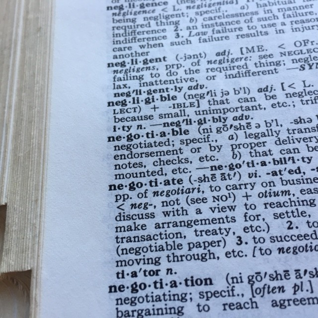 dictionary turned to the word negotiate