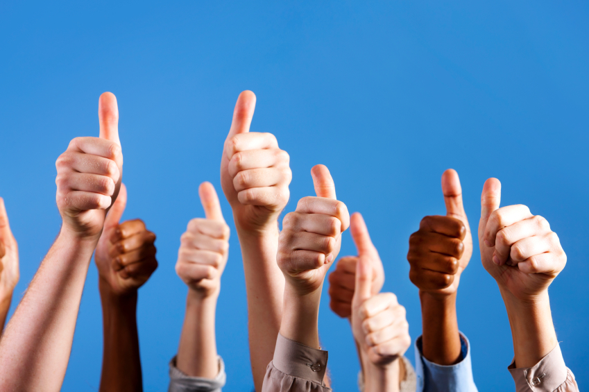 picture of 9 raised fists (different races) in the thumbs up position
