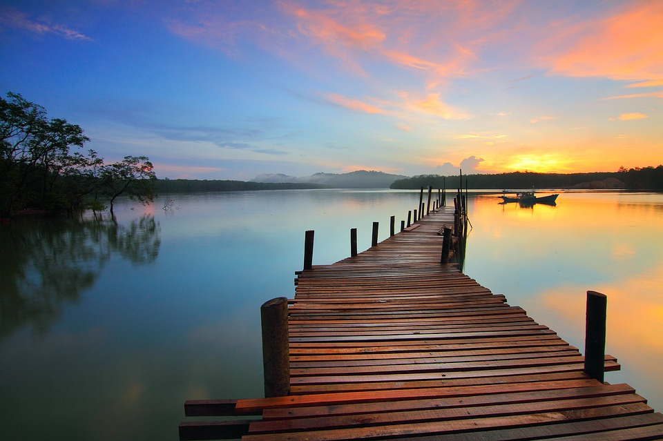 lake at sunrise with long dock