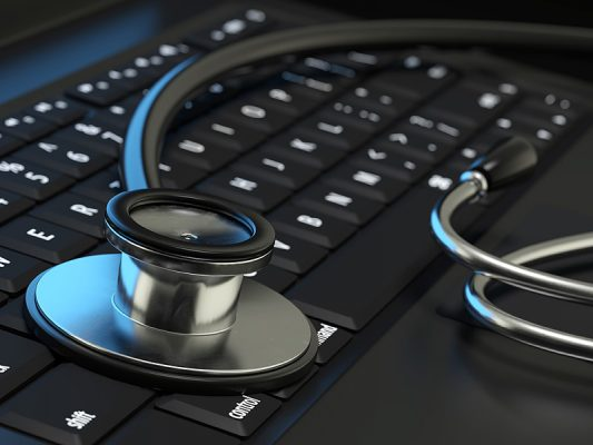 stethoscope resting on keyboard