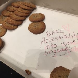 cookies with handwritten sign saying bake accessibility into your organization