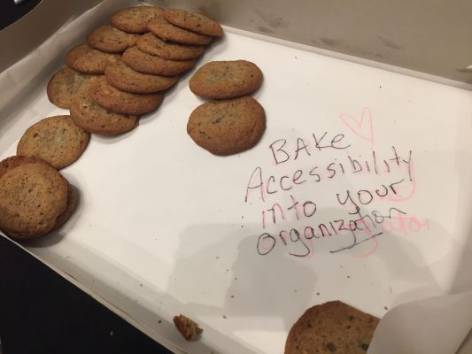 cookies with handwritten sign saying bake accessibility into your organiaztion