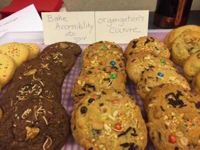 "multi-ingredient cookies with sign reading ""Bake Accessibility into Your Organization"