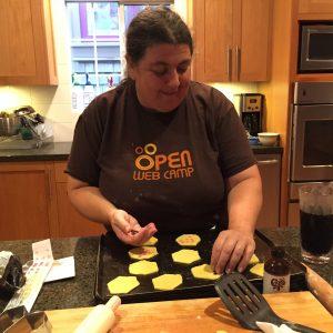woman wearing an Open Web shirt making hexagon cookies