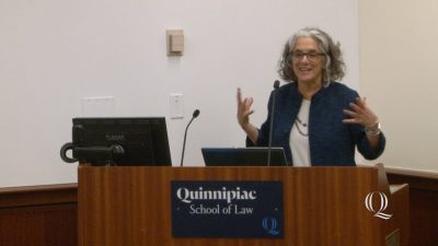 Lainey at lectern at Quinnipiac Law School