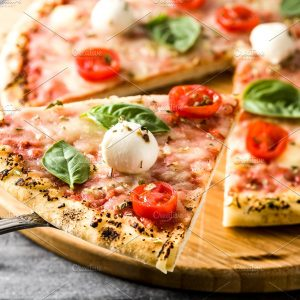pizza with mozzorella, tomato, and basil